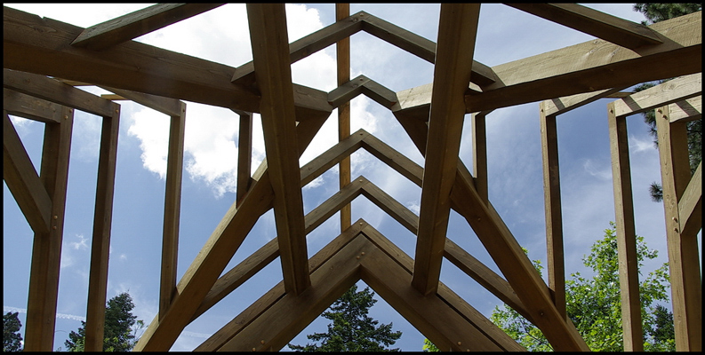 Timber roof framing with compound valley joinery.