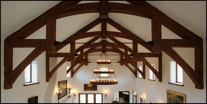Heavy timber hammerbeam trusses with steel tie rod